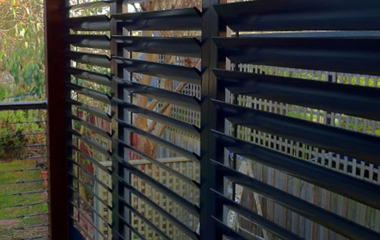 matte black shutters in a Canberra backyard