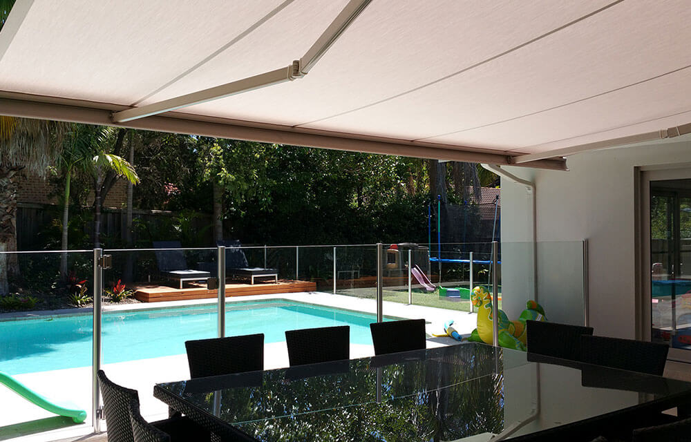 Awnings from the blind shop coveirng a canberra backyward pool