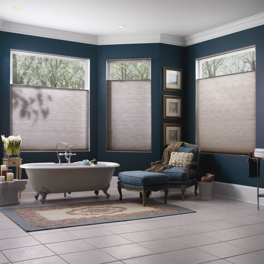 A opulent bathroom using honeycomb cellular blinds, available from The Blind Shop