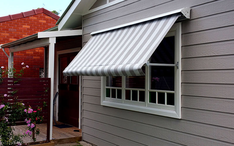 A canberra home with a Pivot Arm Awning from The Blindshop