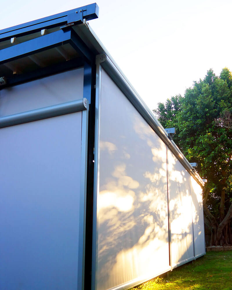 A straight drop awning with filtered sunlight in Canberra