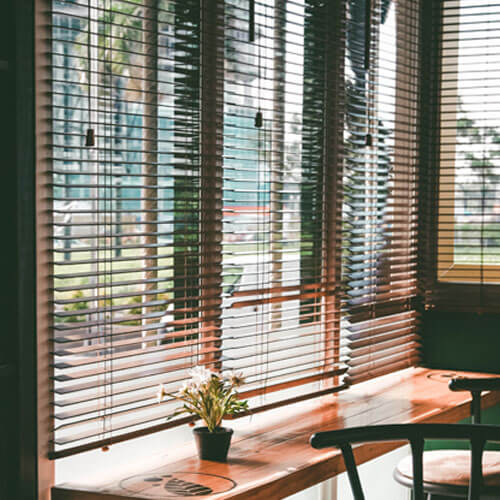 Timber Blinds, like those offered by The Blind Shop, in a sunny canberra cafe