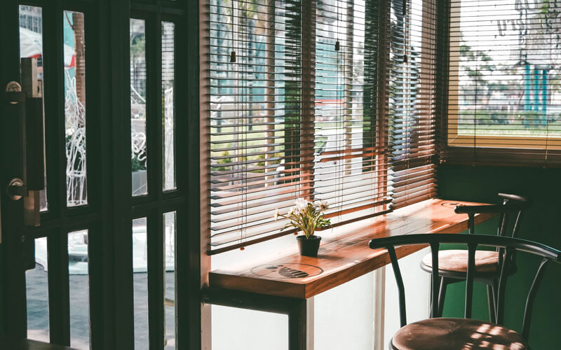 Timber Ventian Blinds in a sunny canberra cafe. get yours from The Blind Shop today!