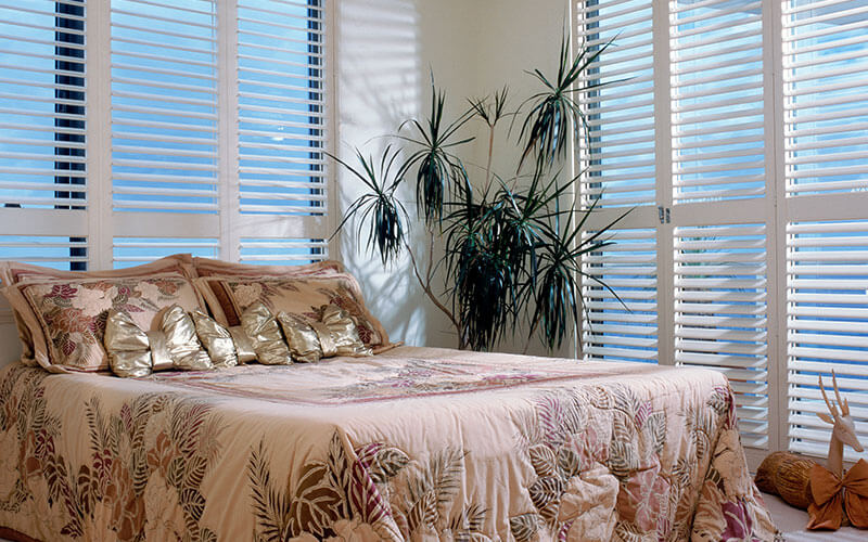 Shutters in a sunny Canberra bedroom, get yours from The Blind Shop today!