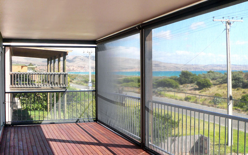 Ziptrak blinds protecting a balcony. Install yours from The Blind Shop today.